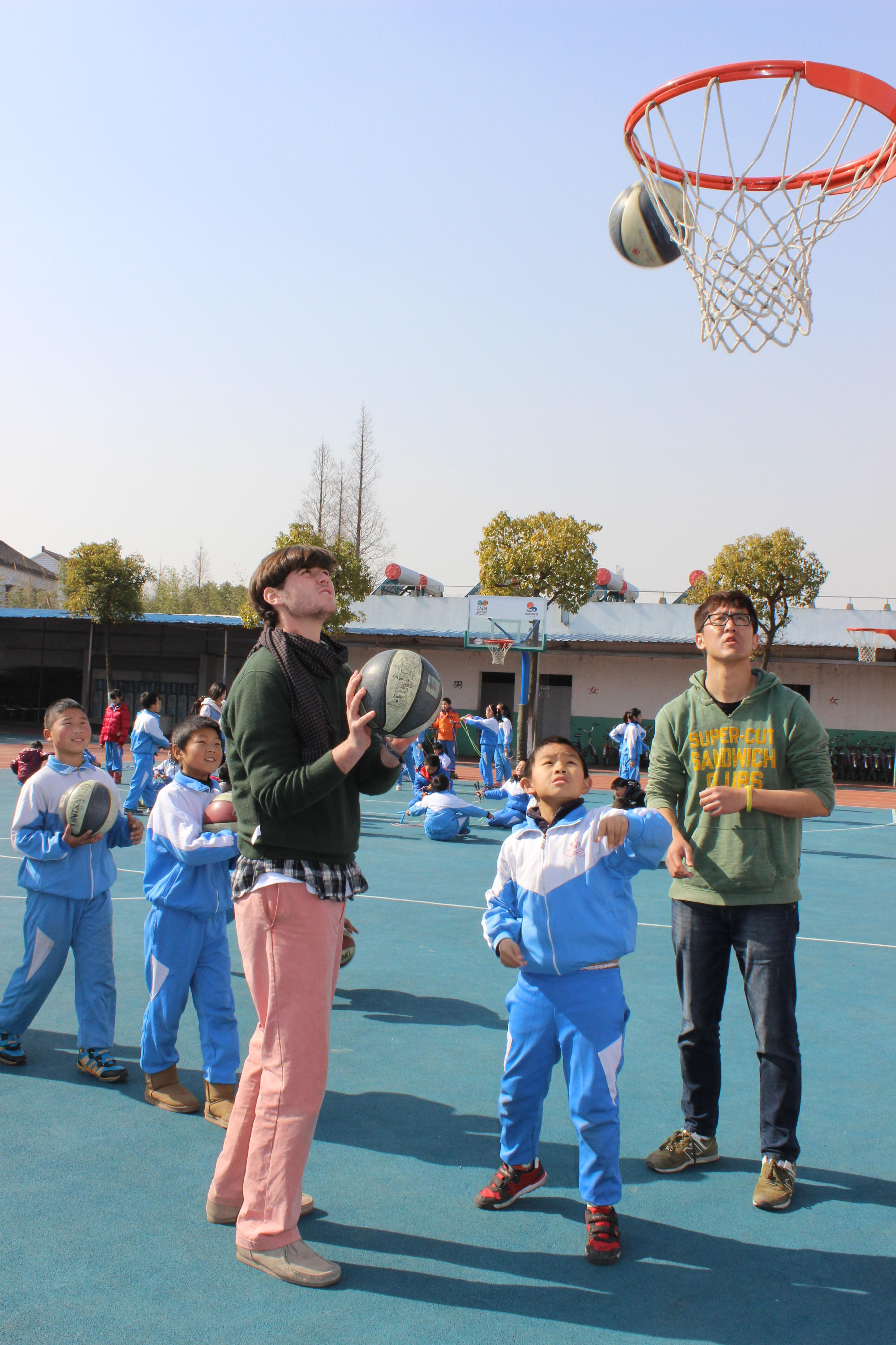 While learning Mandarin in China, a student also volunteers in local school and coaches sports lessons.